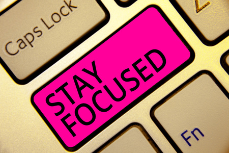 Text sign showing Stay Focused. Conceptual photo Be attentive Concentrate Prioritize the task Avoid distractions Keyboard pink key Intention create computer computing reflection document
