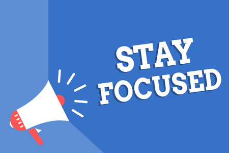 Handwriting text writing Stay Focused. Concept meaning Be attentive Concentrate Prioritize the task Avoid distractions Megaphone loudspeaker blue background important message speaking loud Stock Photo