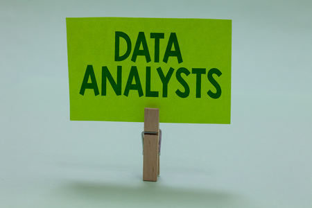 Conceptual hand writing showing Data Analysts. Business photo showcasing Programmer Design and Create Report Identifies patterns Clothespin holding green paper important message ideas