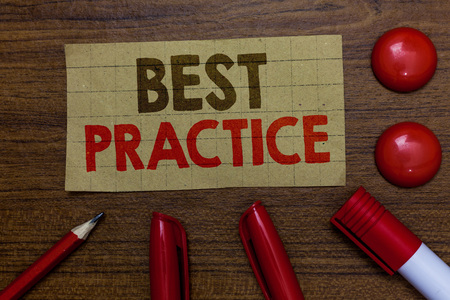 Handwriting text writing Best Practice. Concept meaning Method Systematic Touchstone Guidelines Framework Ethic Paperboard markers pencil wooden background communicating ideas red balls