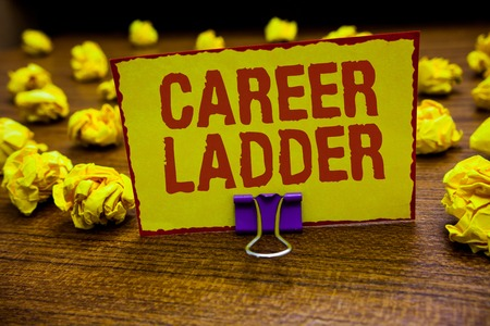 Word writing text Career Ladder. Business concept for Job Promotion Professional Progress Upward Mobility Achiever Clip holding yellow paper note crumpled papers several tries mistakes