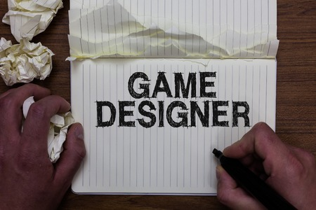 Writing note showing Game Designer. Business photo showcasing Campaigner Pixel Scripting Programmers Consoles 3D Graphics Man holding marker notebook crumpled papers ripped pages mistakes made