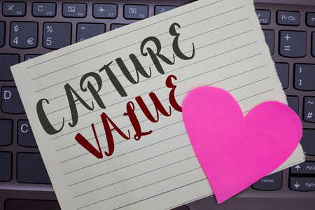 Conceptual hand writing showing Capture Value. Business photo showcasing Customer Relationship Satisfy Needs Brand Strength Retention Notebook paper keyboard Romantic Lovely ideas Type computer