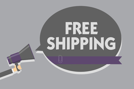 Text sign showing Free Shipping. Conceptual photo Freight Cargo Consignment Lading Payload Dispatch Cartage Man holding megaphone loudspeaker speech bubble message speaking loud Фото со стока