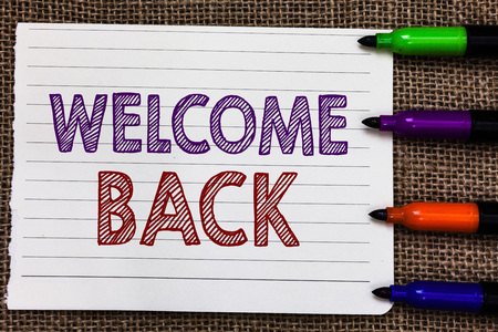 Conceptual hand writing showing Welcome Back. Business photo showcasing Warm Greetings Arrived Repeat Gladly Accepted Pleased Notebook Paper Important reminder Markers Jute background Stockfoto