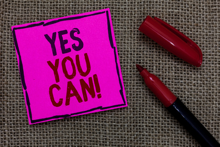 Word writing text Yes You Can. Business concept for Positivity Encouragement Persuade Dare Confidence Uphold Pink paper Important reminder Marker Communicate ideas Jute background Banco de Imagens