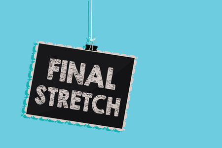 Conceptual hand writing showing Final Stretch. Business photo showcasing Last Leg Concluding Round Ultimate Stage Finale Year ender Hanging blackboard message information sign blue background Stock fotó