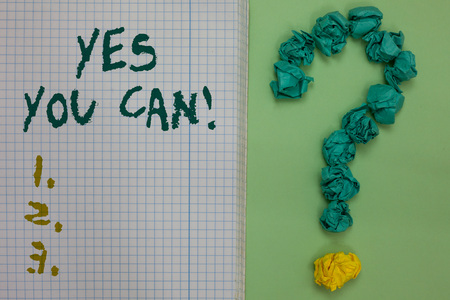Text sign showing Yes You Can. Conceptual photo Positivity Encouragement Persuade Dare Confidence Uphold Notebook paper crumpled papers forming question mark green background