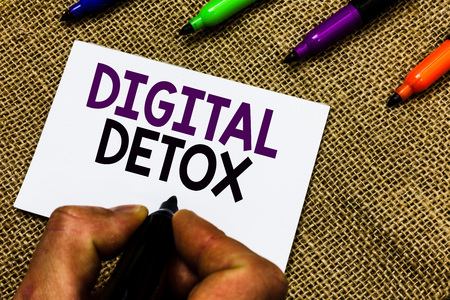 Writing note showing Digital Detox. Business photo showcasing Free of Electronic Devices Disconnect to Reconnect Unplugged Man hand holding marker white paper communicating idea Jute background