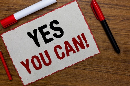 Text sign showing Yes You Can. Conceptual photo Positivity Encouragement Persuade Dare Confidence Uphold White paper red borders markers wooden background communicating ideas