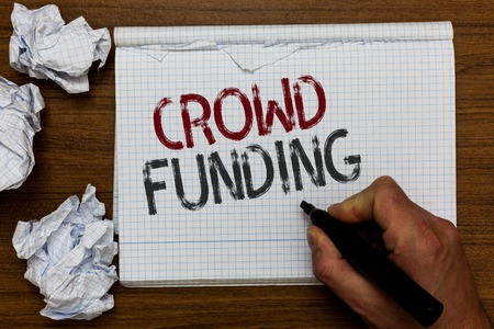 Handwriting text Crowd Funding. Concept meaning Fundraising Kickstarter Startup Pledge Platform Donations Man holding marker notebook crumpled papers ripped pages mistakes made Stock Photo