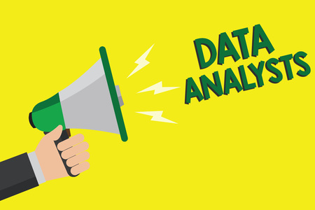 Text sign showing Data Analysts. Conceptual photo Programmer Design and Create Report Identifies patterns Man holding megaphone loudspeaker yellow background message speaking loud Banco de Imagens