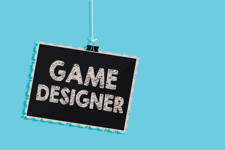 Conceptual hand writing showing Game Designer. Business photo showcasing Campaigner Pixel Scripting Programmers Consoles 3D Graphics Hanging blackboard message information sign blue background