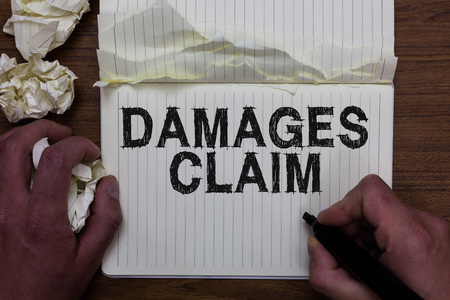 Writing note showing Damages Claim. Business photo showcasing Demand Compensation Litigate Insurance File Suit Man holding marker notebook crumpled papers ripped pages mistakes made