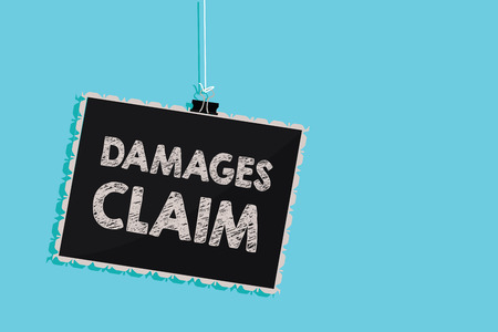 Conceptual hand writing showing Damages Claim. Business photo showcasing Demand Compensation Litigate Insurance File Suit Hanging blackboard message information sign blue background Imagens