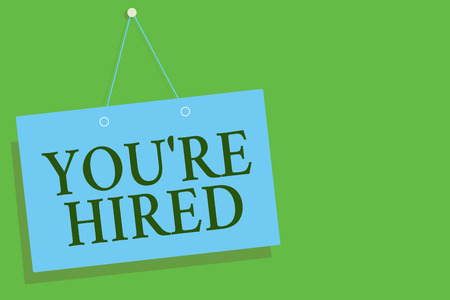 Text sign showing You re are Hired. Conceptual photo New Job Employed Newbie Enlisted Accepted Recruited Blue board wall message communication open close sign green background