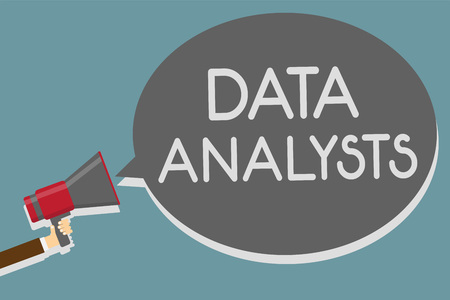Writing note showing Data Analysts. Banco de Imagens