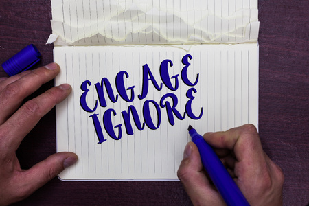 Writing note showing Engage Ignore. Stock Photo