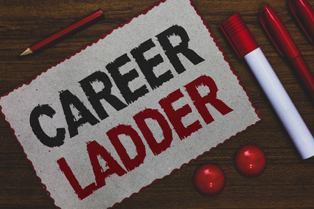 Conceptual hand writing showing Career Ladder. Business photo showcasing Job Promotion Professional Progress Upward Mobility Achiever White paper red borders markers pencils wooden background Stok Fotoğraf