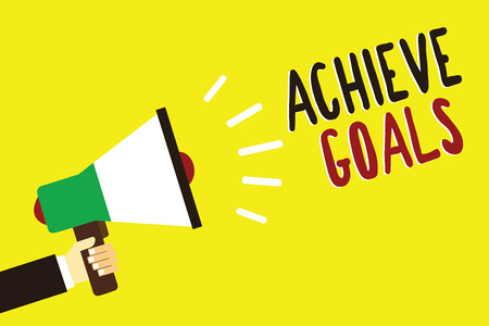 Text sign showing Achieve Goals. Conceptual photo Results oriented Reach Target Effective Planning Succeed Man holding megaphone loudspeaker yellow background message speaking loud