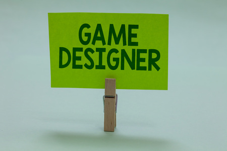 Conceptual hand writing showing Game Designer. Business photo showcasing Campaigner Pixel Scripting Programmers Consoles 3D Graphics Clothespin holding green paper important message ideas