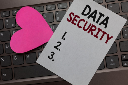 Handwriting text Data Security. Concept meaning Confidentiality Disk Encryption Backups Password Shielding Paper Romantic lovely message Heart Keyboard Type computer Good feelings
