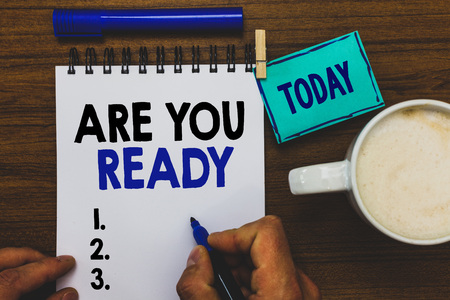 Conceptual hand writing showing Are You Ready. Business photo text Alertness Preparedness Urgency Game Start Hurry Wide awake Man holding marker notebook clothepin reminder wooden table coffee