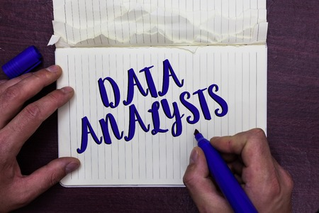 Writing note showing Data Analysts. Business photo showcasing Programmer Design and Create Report Identifies patterns Man holding marker notebook page crumpled paper several tries mistakes