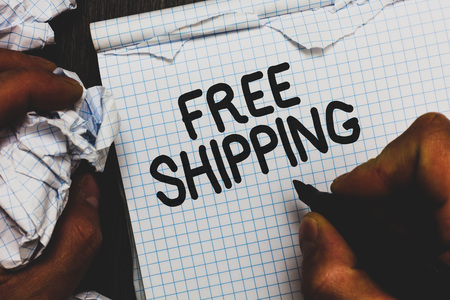 Handwriting text Free Shipping. Concept meaning Freight Cargo Consignment Lading Payload Dispatch Cartage Man holding marker notebook crumpled papers ripped pages mistakes made