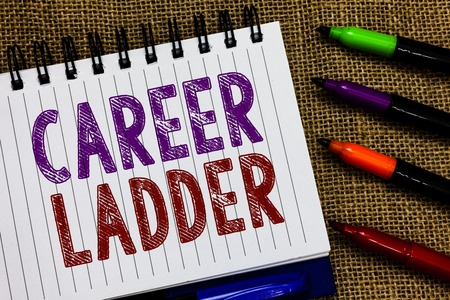 Text sign showing Career Ladder. Conceptual photo Job Promotion Professional Progress Upward Mobility Achiever Open spiral notebook page jute background colorful markers Expressing ideas