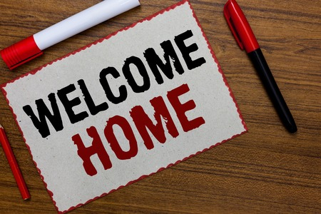 Text sign showing Welcome Home. Conceptual photo Expression Greetings New Owners Domicile Doormat Entry White paper red borders markers wooden background communicating ideas