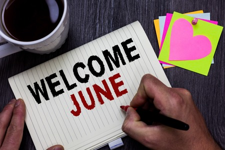 Conceptual hand writing showing Welcome June. Business photo text Calendar Sixth Month Second Quarter Thirty days Greetings Man holding marker giving ideas wooden table cup coffee hearts