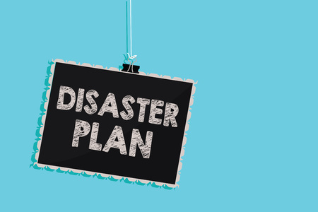 Conceptual hand writing showing Disaster Plan. Business photo showcasing Respond to Emergency Preparedness Survival and First Aid Kit Hanging blackboard message information sign blue background