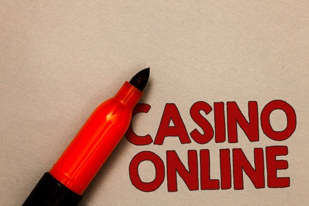 Word writing text Casino Online. Business concept for Computer Poker Game Gamble Royal Bet Lotto High Stakes Open red marker intention communicating message ideas beige background