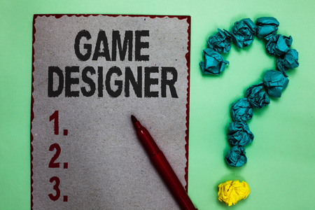 Handwriting text writing Game Designer. Concept meaning Campaigner Pixel Scripting Programmers Consoles 3D Graphics Gray paper marker crumpled papers forming question mark green background