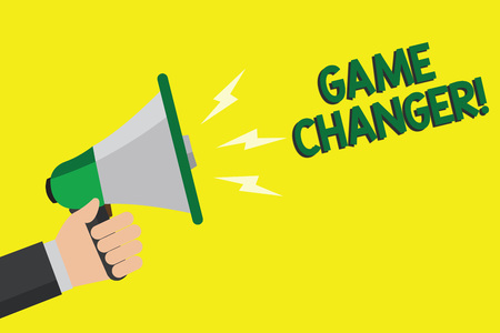Text sign showing Game Changer. Conceptual photo Sports Data Scorekeeper Gamestreams Live Scores Team Admins Man holding megaphone loudspeaker yellow background message speaking loud Stock Photo