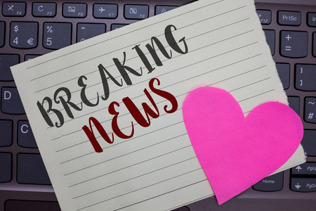 Conceptual hand writing showing Breaking News. Business photo showcasing Special Report Announcement Happening Current Issue Flashnews Notebook paper keyboard Romantic Lovely ideas Type computer
