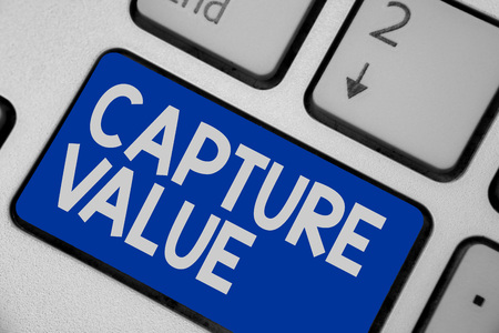 Writing note showing Capture Value. Business photo showcasing Customer Relationship Satisfy Needs Brand Strength Retention Keyboard blue key Intention computer computing reflection document