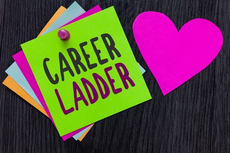Text sign showing Career Ladder. Conceptual photo Job Promotion Professional Progress Upward Mobility Achiever Papers Romantic lovely message Heart Good feelings Wooden background Stok Fotoğraf