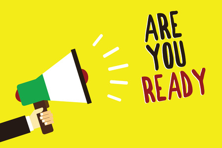 Text sign showing Are You Ready. Conceptual photo Alertness Preparedness Urgency Game Start Hurry Wide awake Man holding megaphone loudspeaker yellow background message speaking loud
