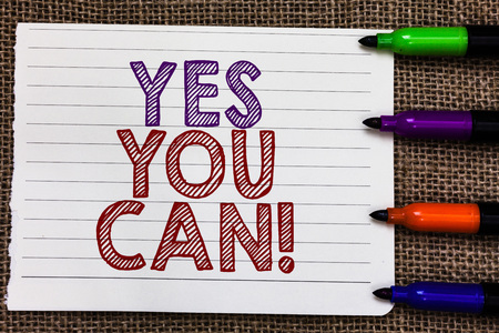 Conceptual hand writing showing Yes You Can. Business photo showcasing Positivity Encouragement Persuade Dare Confidence Uphold Notebook Paper Important reminder Markers Jute background Banco de Imagens