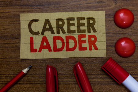 Handwriting text writing Career Ladder. Concept meaning Job Promotion Professional Progress Upward Mobility Achiever Paperboard markers pencil wooden background communicating ideas red balls