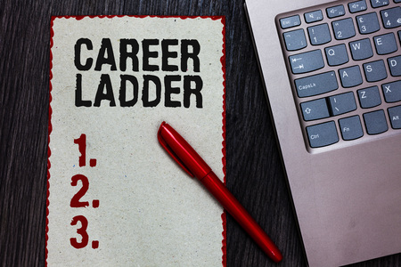 Handwriting text writing Career Ladder. Concept meaning Job Promotion Professional Progress Upward Mobility Achiever Piece paper red borders black marker computer keyboard wooden background