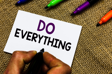 Writing note showing Do Everything. Business photo showcasing Jack of All Trades Self Esteem Ego Pride No Limits Man hand holding marker white paper communicating idea Jute background
