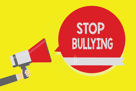 Handwriting text Stop Bullying. Concept meaning Fight and Eliminate this Aggressive Unacceptable Behavior Man holding megaphone loudspeaker red speech bubble yellow background