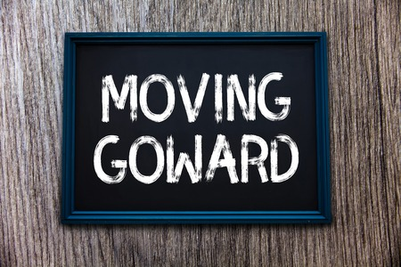 Handwriting text Moving Goward. Concept meaning Towards a Point Move on Going Ahead Further Advance Progress.