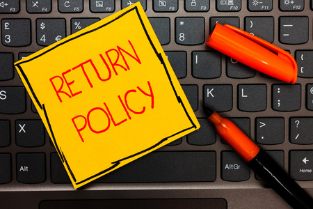 Writing note showing Return Policy. Business photo showcasing Tax Reimbursement Retail Terms and Conditions on Purchase Yellow paper keyboard Inspiration communicate ideas orange markers 스톡 콘텐츠