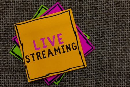 Text sign showing Live Streaming. Conceptual photo Transmit live video coverage of an event over the Internet Paper notes Important reminders Communicate ideas messages Jute background Reklamní fotografie