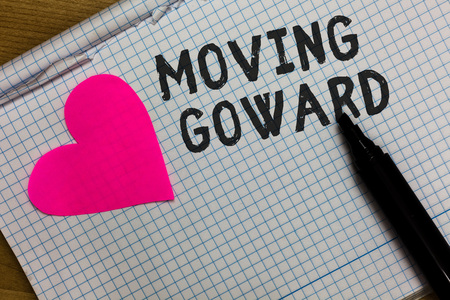 Text sign showing Moving Goward. Conceptual photo Towards a Point Move on Going Ahead Further Advance Progress Squared notebook paper ripped sheets Marker romantic ideas pink heart Stock fotó