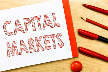 Handwriting text writing Capital Markets. Concept meaning Allow businesses to raise funds by providing market security. Stock Photo